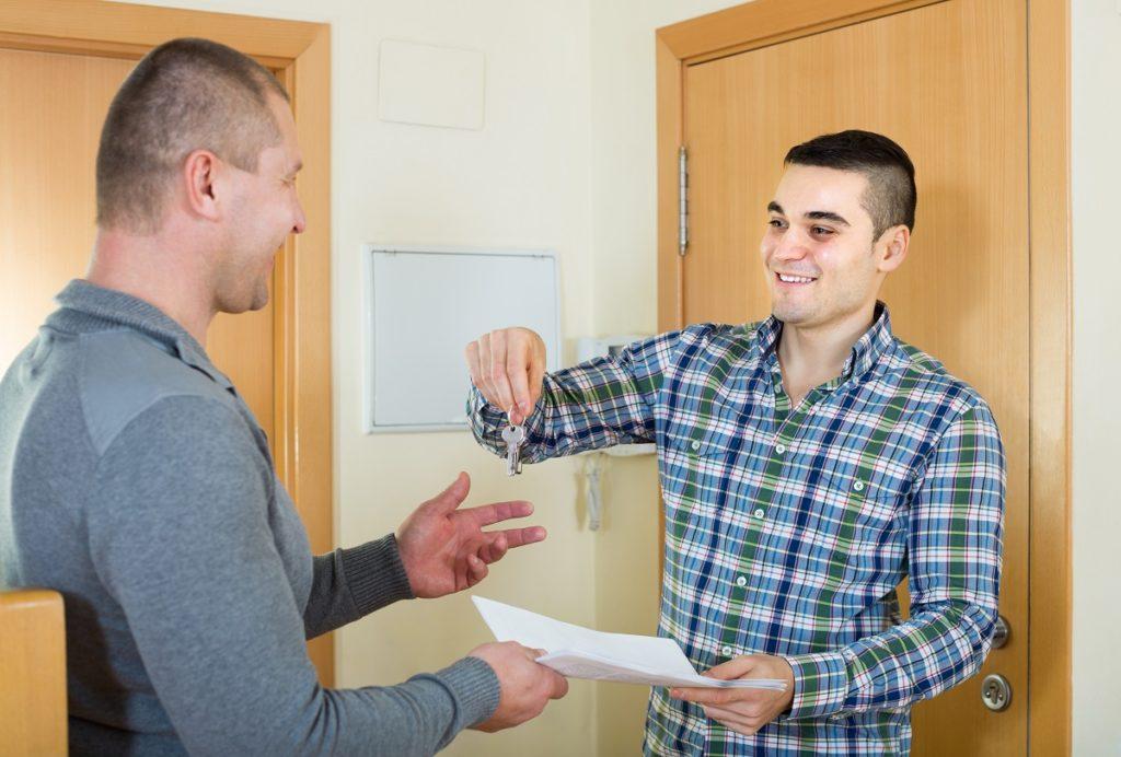 landlord handing keys to renter