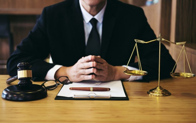 half shot of a lawyer on his desk
