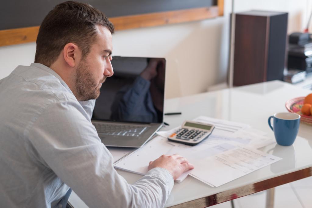 businessman looking at finances