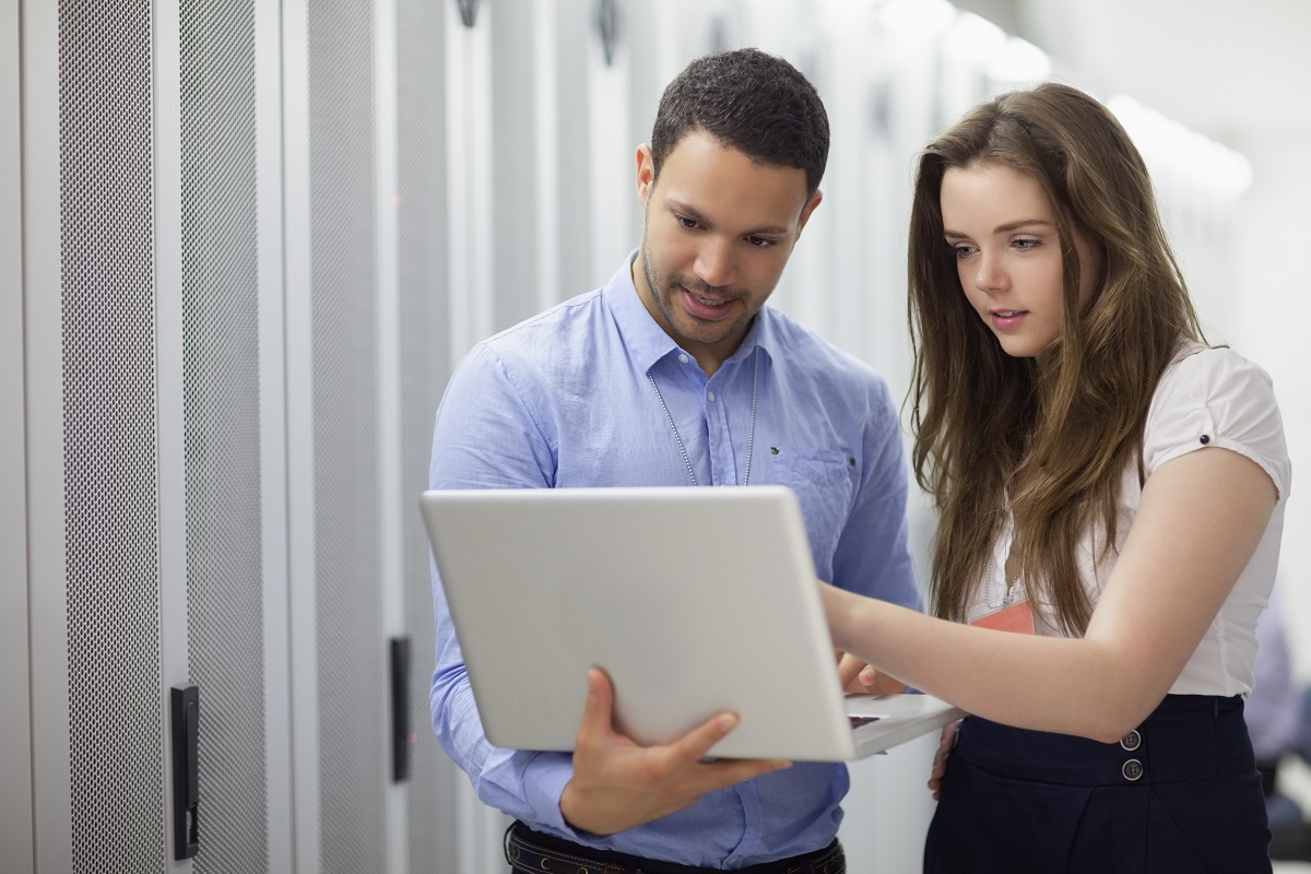 employees using laptop for discussion