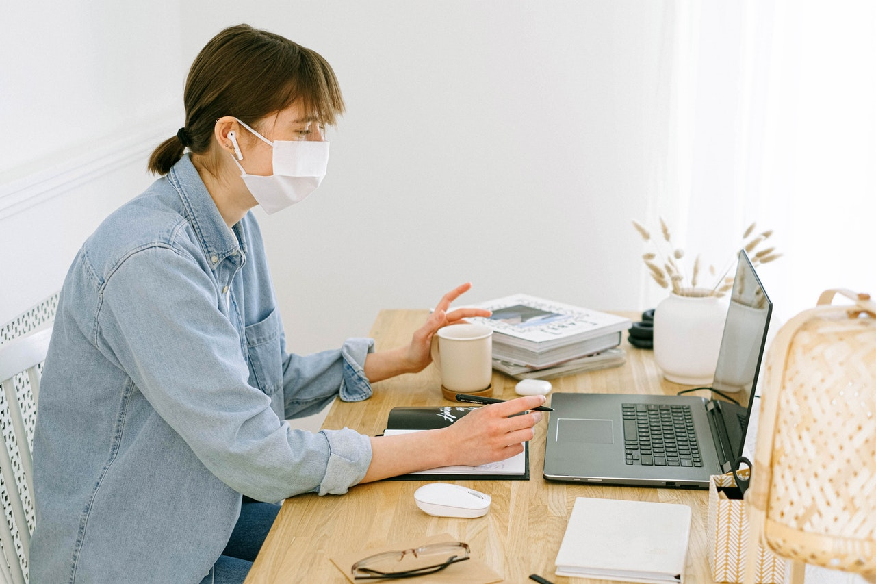person working with mask