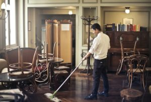 a man mopping the floor