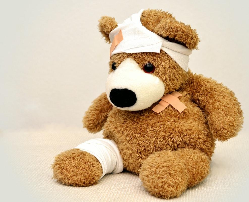injured toy bear
