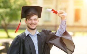 graduation holding diploma
