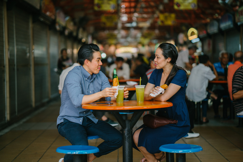 man and woman in food stall