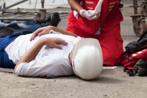 man laying on the ground injured