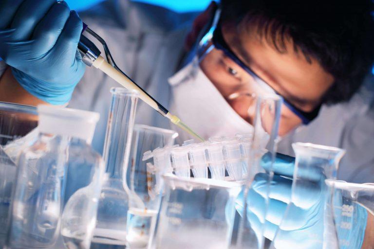chemist mixing chemicals
