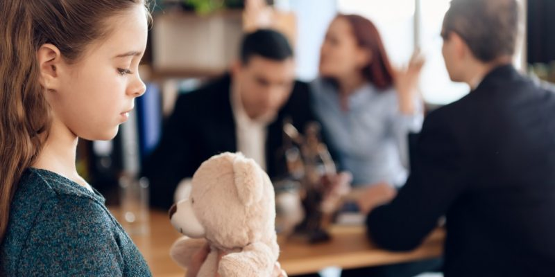 child and parent at a family lawyer's office